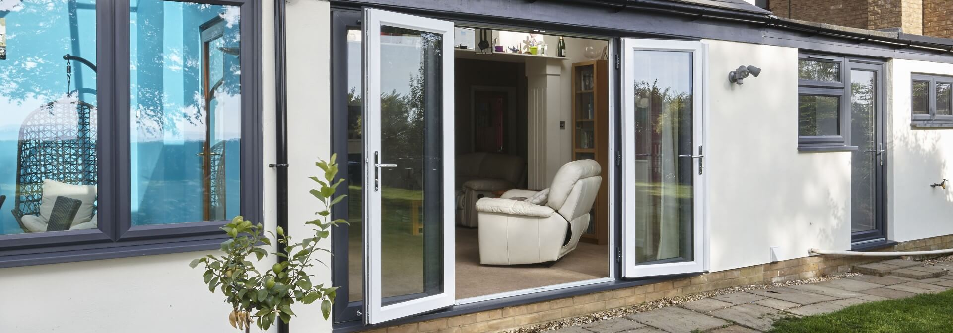 French doors fitted for homeowners in Essex and Suffolk with grey external colour and white internal colour