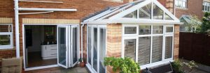 Gable front conservatory with brick structure