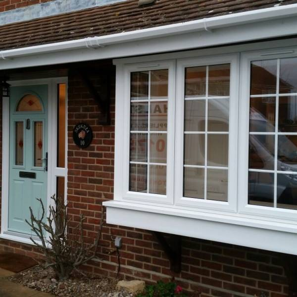 uPVC casement windows in white with astragal bars