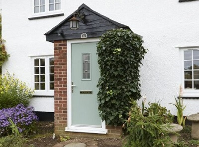 A composite front door in traditional chartwell green colour
