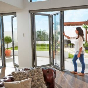 Bifold doors being folded down to open out a living area
